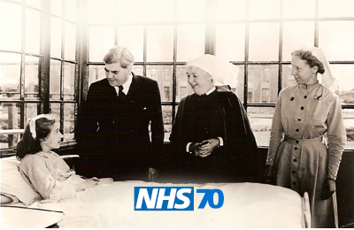 Aneurin Bevan and NHS nurses at a patient's beside in 1948