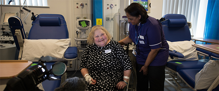 An NHSBT nurse and patient smiling