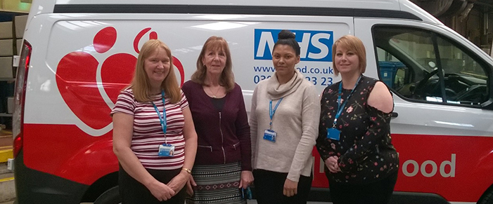 An NHSBT apprenticeship team stand in front of a blood delivery van