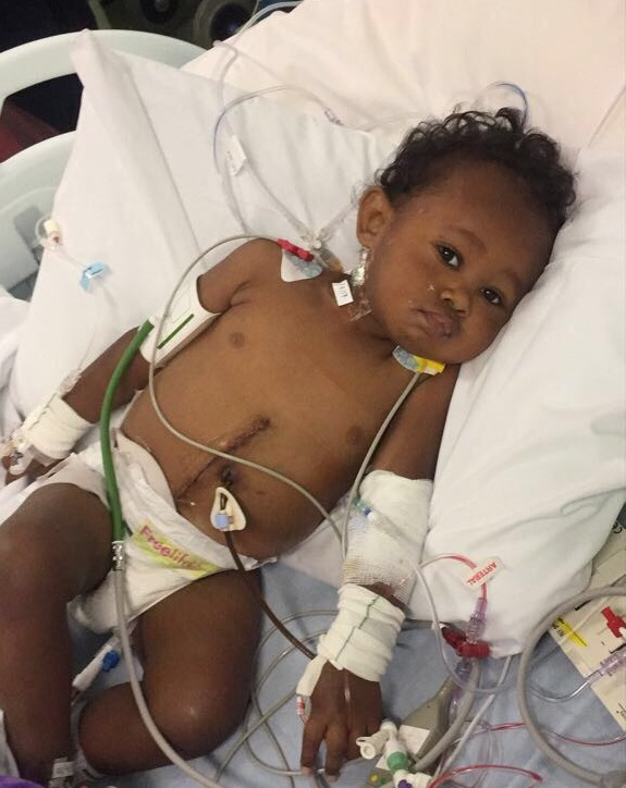 Child in a hospital bed after transplant