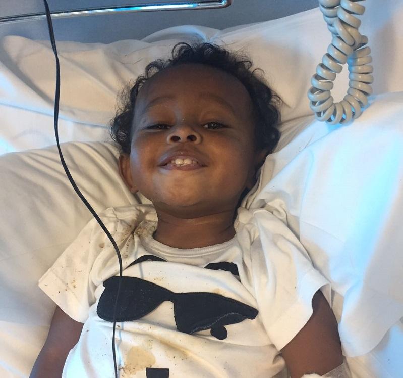 Mason in a hospital bed